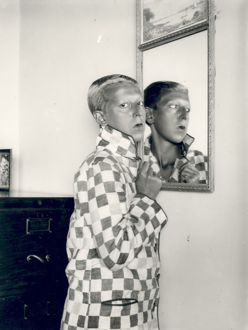 self portrait (reflected in mirror, chequered jacket) 1928